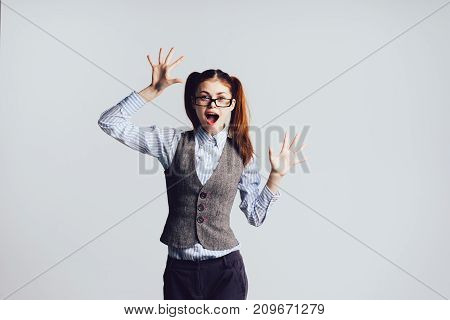 a girl in glasses glasses happily waving her arms