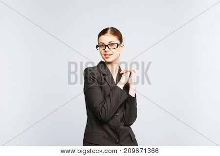girl secretary with glasses joyfully folded her arms in front of her