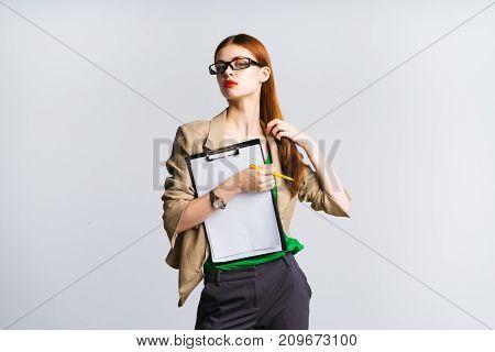 girl secretary in glasses posing on white background