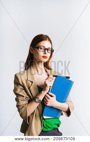girl secretary in glasses holds folders in hands