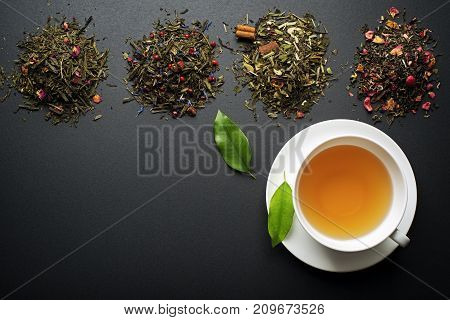 Cup of tea with dry tea collection of different types