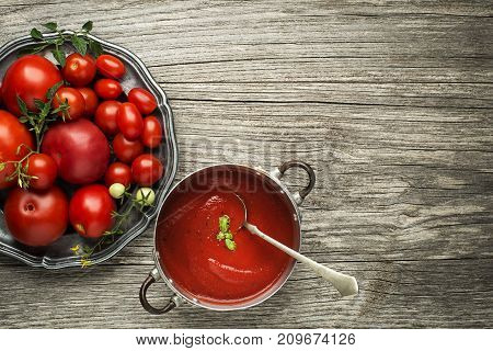 Fresh tomato sauce on wooden background. Top view