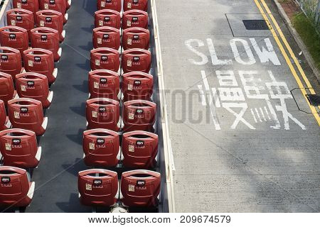 Open double decker bus with red chairs from high angle view with roadsign slow at the street, Hong Kong, Asia