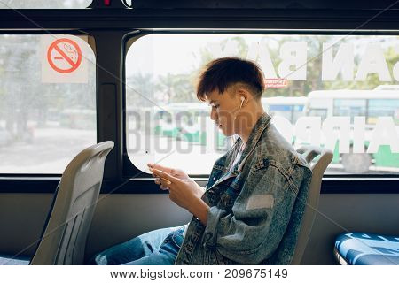 Public Transport. People In The Bus. Asian Man Sitting Inside City Bus.