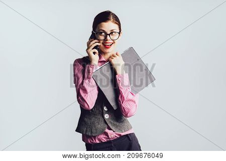 girl secretary wearing glasses smiling talking on the phone