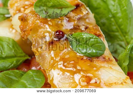Pike perch fillet with vegetables on white background