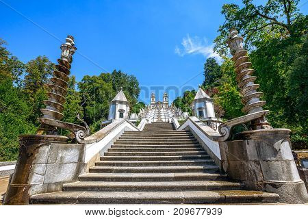 Sanctuary of Bom Jesus do Monte on top of a monumental baroque staircase of 116 meters. Perspective view from down to up. Popular landmark and pilgrimage site in northern Portugal, Tenoes in Braga.