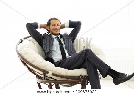 successful businessman sitting in a large comfortable chair