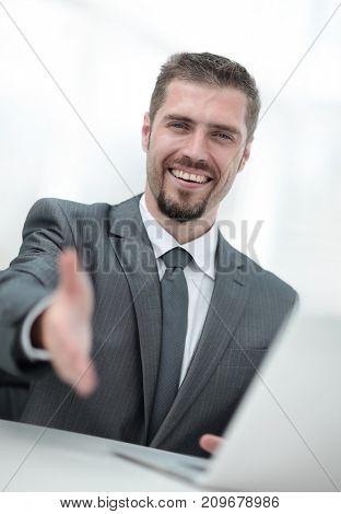 closeup .a successful businessman extends his hand for a handshake,