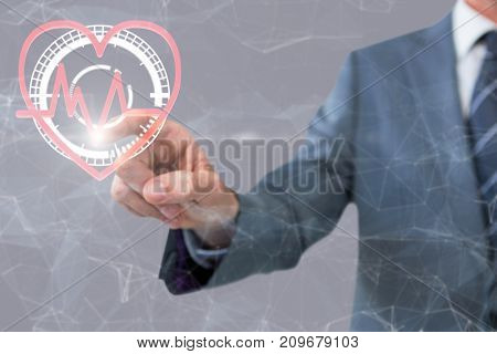 Midsection of businessman pointing against grey background