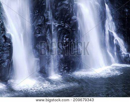 Close up waterfall at Huay Mae Kamin Waterfall beautiful waterfall in autumn forest and wood pier Kanchanaburi province Thailand