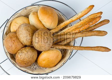 Homemade bread in food basket on white background