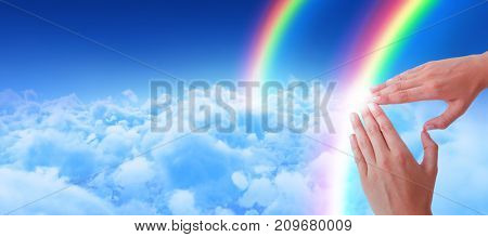 Woman making heart shape with hands against view of overcast against blue sky