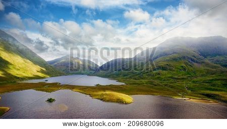 Tranquil scene of lake and mountains against sky