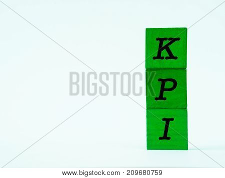 The KPI alphabet on white table background.