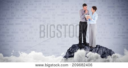 Business people discussing over tablet computer against blue brick background