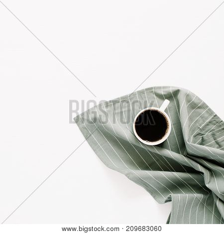 Coffee mug on pastel cloth isolated on white background. Flat lay top view minimal concept.