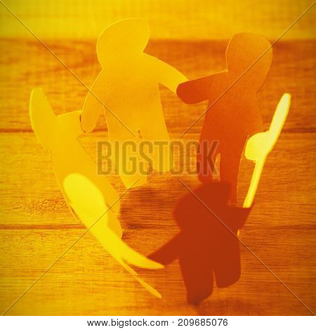 High angle view of colorful paper figures forming circle on table