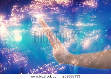 Hand of man pretending to touch invisible screen against illustration of mathematical equations