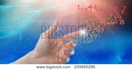 Hand of man pretending to touch an invisible screen against digitally composite image of colorful lights