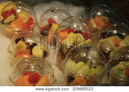 Fresh fruit on ice at a self service restaurant