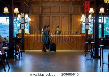 Young couple checking in at hotel reception