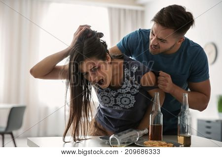 Young woman subjecting to violence at home