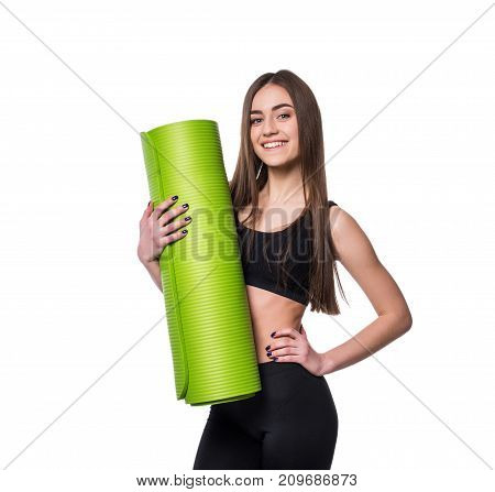 Young Attractive Fitness Woman Ready For Workout Holding Green Yoga Mat Isolated On White Background
