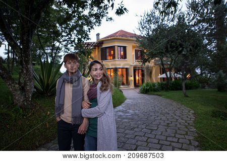 Young Vietnamese couple in warm clothes exploring hotel territory