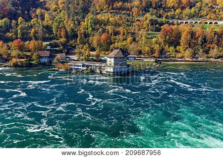 Laufen, Switzerland - 18 October, 2017: the Rhine river just below the Rhine Falls waterfall, view from the Laufen castle. The Rhine Falls is the largest waterfall in Europe, located on the border between the Swiss cantons of Zurich and Schaffhausen.
