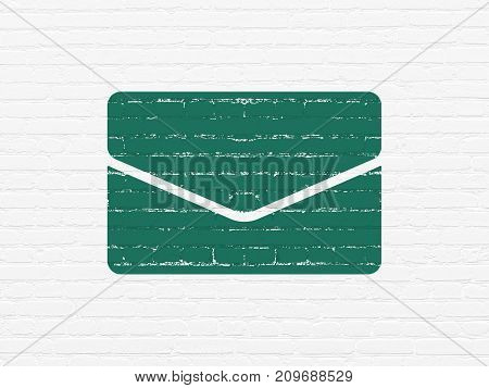 Business concept: Painted green Email icon on White Brick wall background