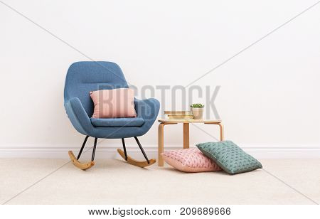 Interior of beautiful room with rocking chair and light carpet