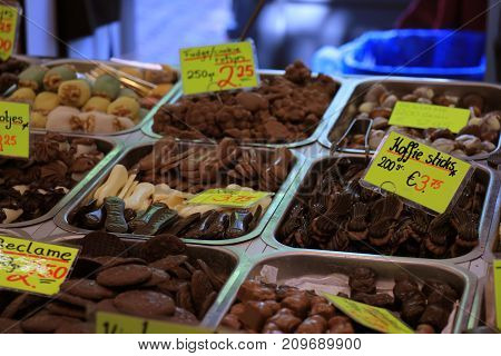 Chocolates on display on a confectioner's market stall (tags: prices and product information in Dutch fudge and coffee candy bars)