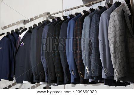 Stylish male jackets in menswear store