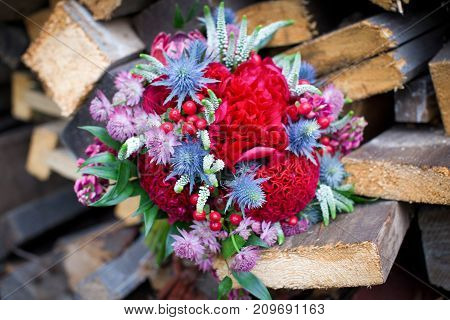 Bridal bouquet in rustic style lying on the stump outdoors. wedding concept.