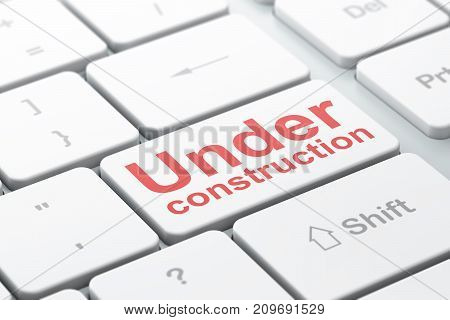 Web development concept: computer keyboard with word Under Construction, selected focus on enter button background, 3D rendering