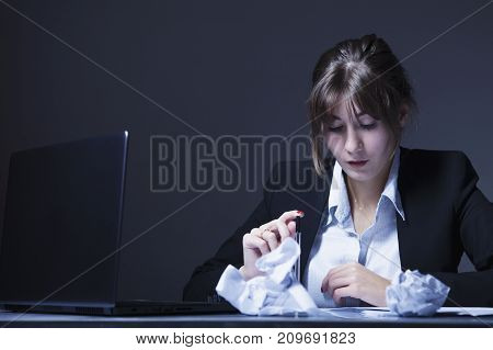 I hate my office work. Office hell. Woman going crazy with work with documents. Low wages overtime working hours lack of career prospects concept. (Body language gestures psychology)