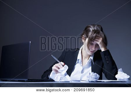 I hate my office work. Young businesswoman working with documents. Low wages overtime working hours lack of career prospects concept. (Body language gestures psychology concept)