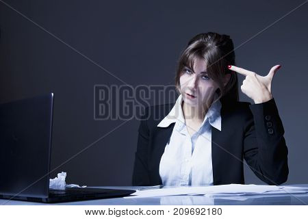I hate my office work. Young businesswoman working with documents. Low wages overtime working hours lack of career prospects concept. (Body language gestures psychology)