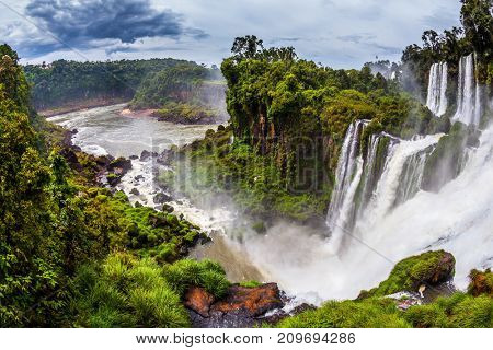 Complex of waterfalls Iguazu on the border of Argentina, Brazil and Paraguay. Picturesque basaltic ledges form the famous waterfalls. The concept of active and exotic tourism