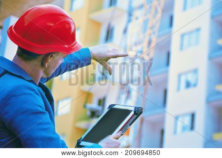 Successful architect in suit and helmet (engineer construction worker concept)