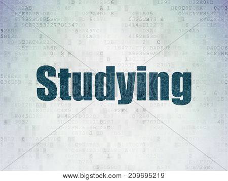 Studying concept: Painted blue word Studying on Digital Data Paper background