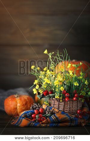 The table decorated with flowers and vegetables. Harvest holiday, Happy Thanksgiving Day. Autumn background.