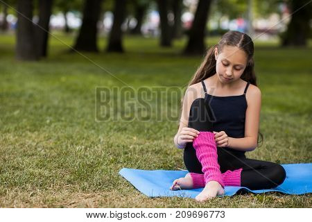 Teenage healthy lifestyle. Outdoor activity. Beauty young girl style, yoga for teenagers. Nature background with free space, sport concept
