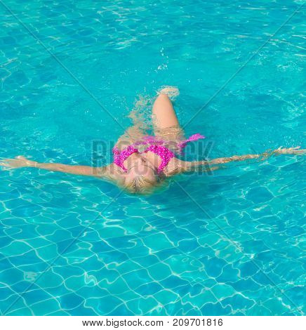 Swimming Beauty In a Blue Pool