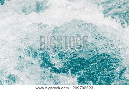 background of stormy water with splashes . In the park in nature