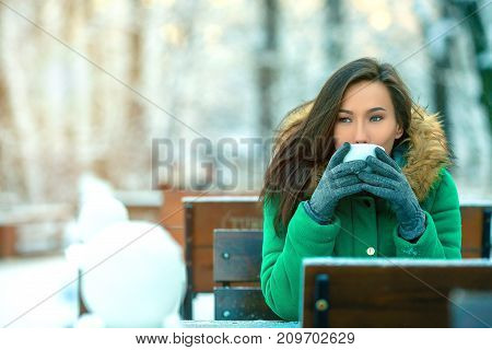 Girl Drinking Hot Tea In The Winter Forest Close Up