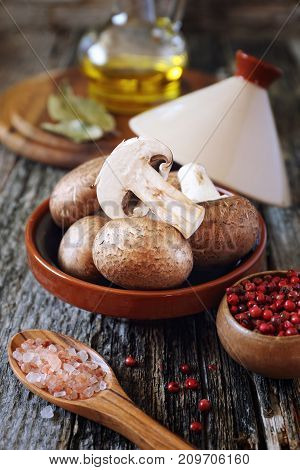 Fresh mushroom champignon in tajin and olive oil