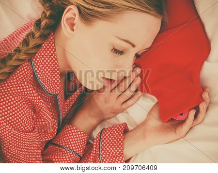 Woman Sleeping With Warm Red Hot Water Bottle