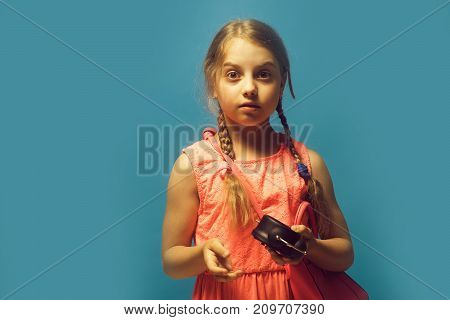 Girl With Black Alarm Clock Isolated On Blue Background